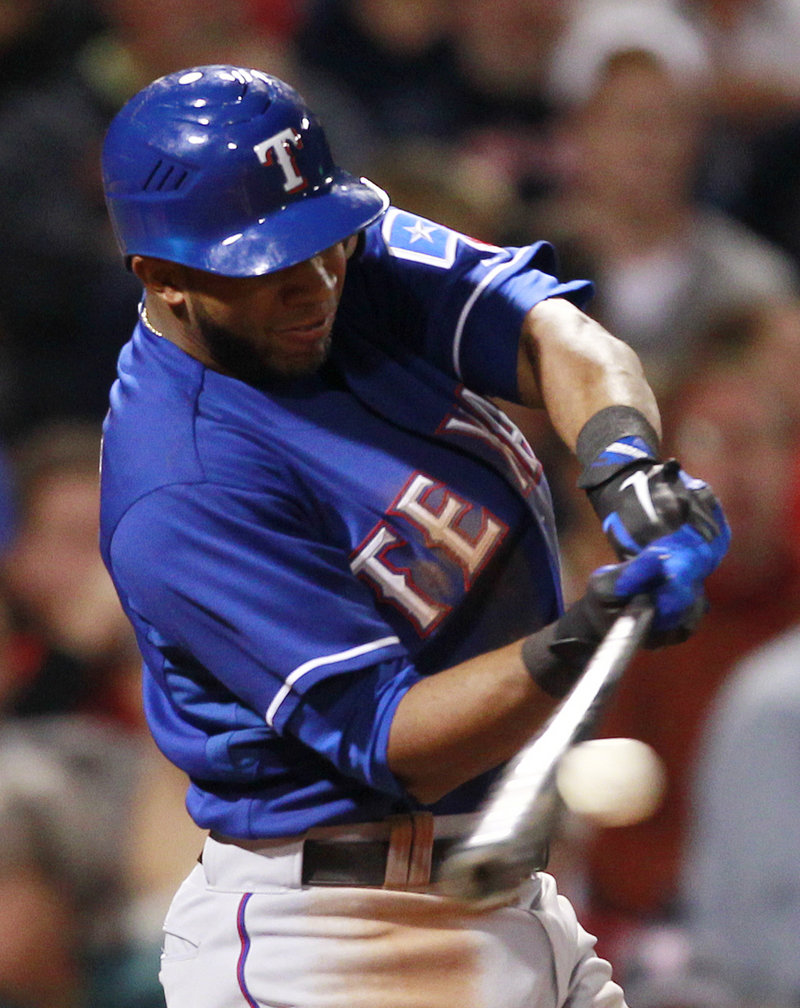 Elvis Andrus hits a two-run home run during the Rangers' 10-0 win over the Red Sox on Friday night in Boston.