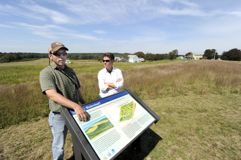 Jeff Feaga, wildlife biologist, and Sue Bickford, natural resources specialist, are trying to manage the land at the Wells National Estuarine Research Reserve to bring back the cottontail rabbit.