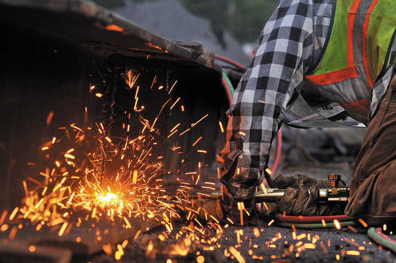 Greg Rich, a welder with Reed & Reed, prepares a beam for placement.