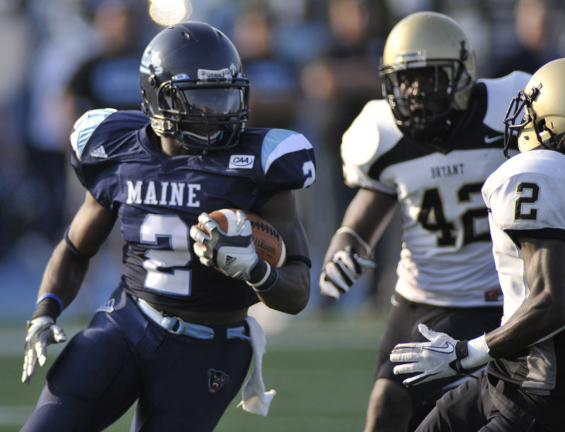 Pushaun Brown turns the corner and picks up yardage Saturday during the University of Maine's 28-13 season-opening win against Bryant. Brown gained 146 yards.