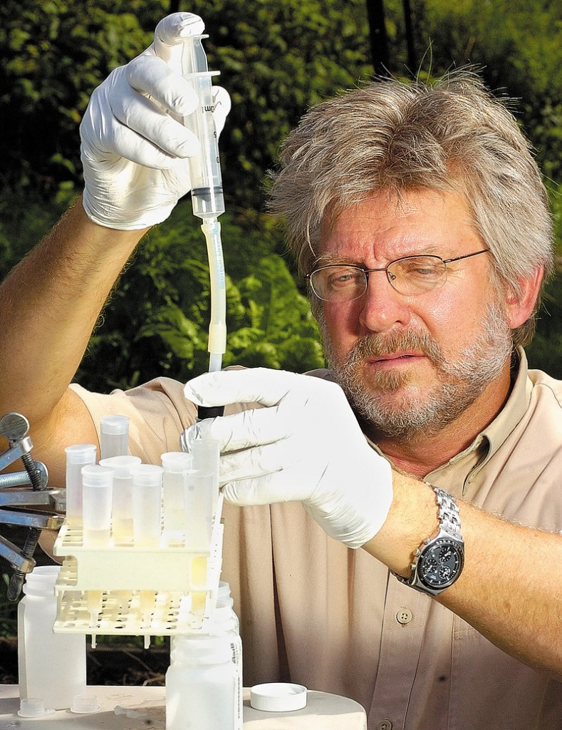 Charles Culbertson, a scientist with the U.S. Geological Survey-Maine Water Science Center, demonstrates some of the equipment that he uses to test well water.