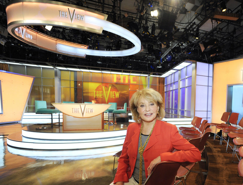 """Barbara Walters poses on the new set of the daytime talk show """"The View,"""" which starts its 15th season Tuesday."""