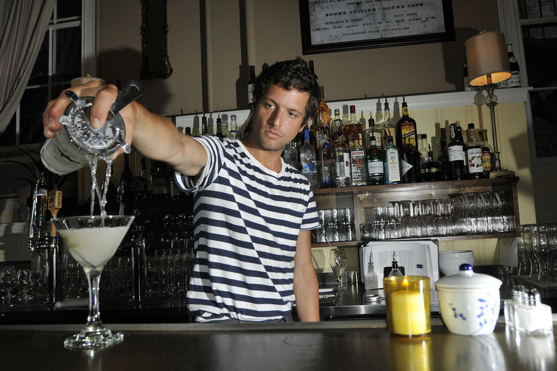 Joshua Loring, a bartender at Petite Jacqueline in Portland, pours a Flaneur, made with Bombay Sapphire gin,