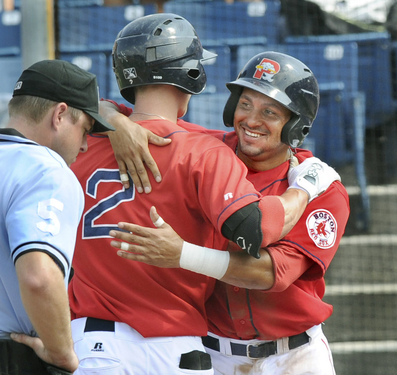 Jeremy Hazelbaker, left, and Ryan Dent celebrate after Hazelbaker's two-run homer Monday in Portland's final game of the 2011 season, at Hadlock Field.