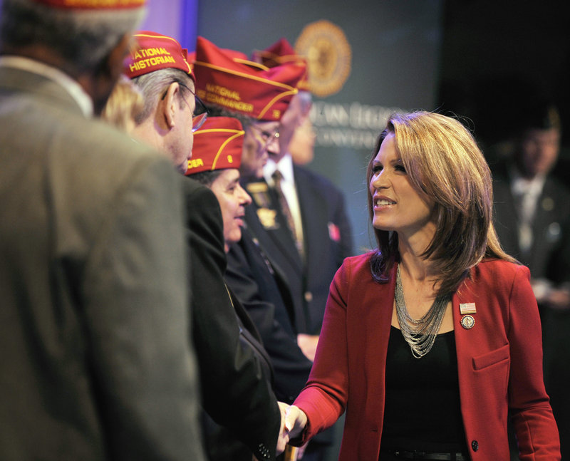 Republican presidential candidate Rep. Michele Bachmann, R-Minn., greets American Legion officers after addressing the national convention last Thursday in Minneapolis. Bachmann opened a tea party-backed forum Monday in South Carolina.