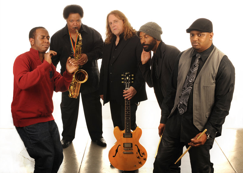 Former Portland resident Nigel Hall, left, performs in Portland on Saturday with the Warren Haynes Band. Haynes is pictured in the middle with the guitar.