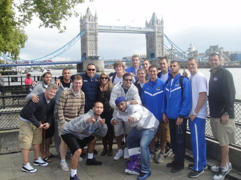 With Tower Bridge as a backdrop, players, coaches and alumni of the St. Joseph s basketball team pose for a photo during their recent offseason trip to England, where they soaked up the culture, bonded and played some basketball, too.