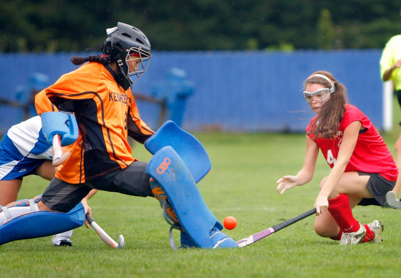 Kennebunk goalie Katherine Cotton knocks the ball away on a shot by Alicia Noonhester of Sanford during Sanford s 2-0 victory Tuesday.