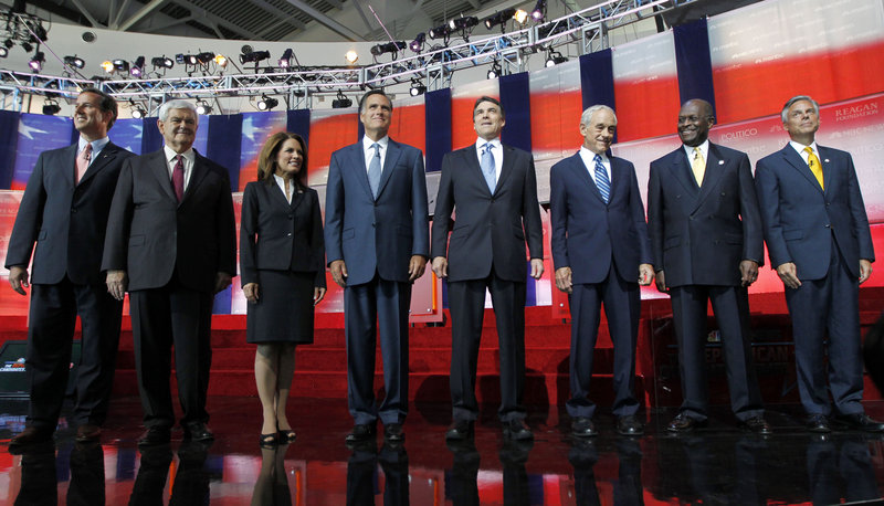Republican presidential candidates at Wednesday's debate, from left, former Pennsylvania Sen. Rick Santorum, former House Speaker Newt Gingrich, Minnesota Rep. Michele Bachmann, former Massachusetts Gov. Mitt Romney, Texas Gov. Rick Perry, Texas Rep. Ron Paul, businessman Herman Cain and former Utah Gov. Jon Huntsman.