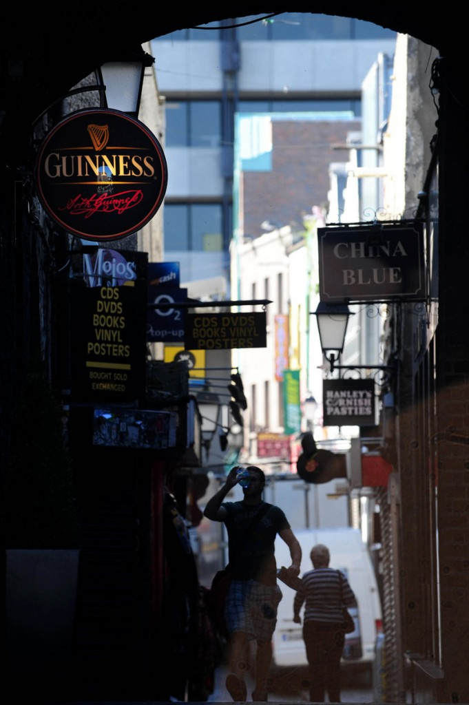 Pedestrians walk along Temple Bar in Dublin. Europe's continuing debt crisis threatens to undermine Ireland's hard work to get its financial house in order.