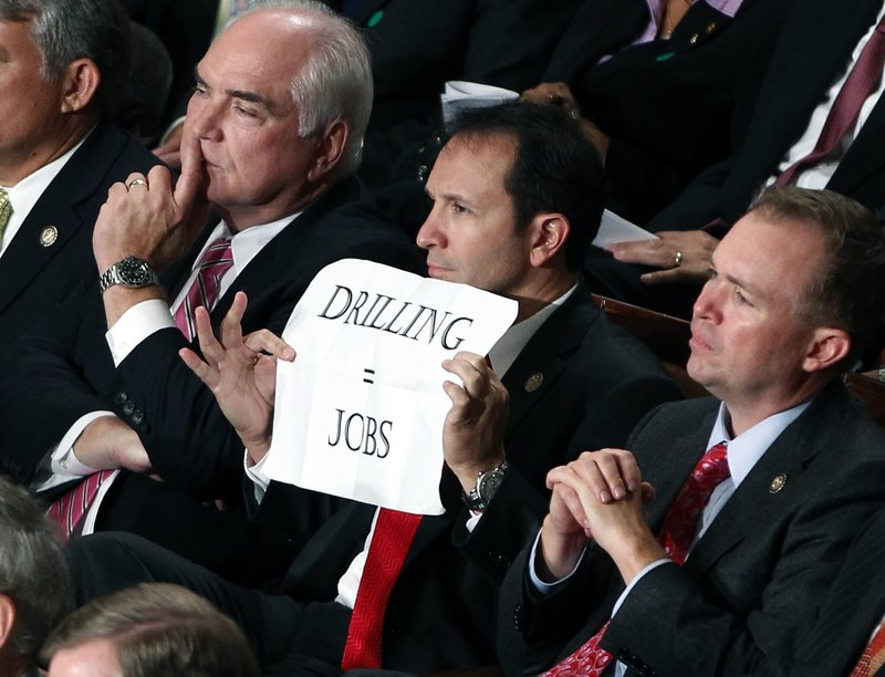 Rep. Jeff Landry, R-La., holds a sign during President Barack Obama's speech to a joint session of Congress at the Capitol in Washington on Thursday night. Republicans mostly expressed their dissent by sitting silently.