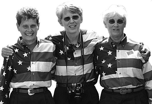 It's September 2010. I'm standing on Main Street in Freeport with Elaine Greene, Carmen Footer and JoAnne Miller, better known as the Freeport Flag Ladies.