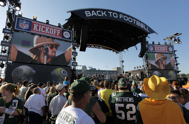 Kid Rock performs during a kickoff concert on Thursday before a game between the Green Bay Packers and the New Orleans Saints in Green Bay, Wis. The football season supports about 110,000 jobs in NFL cities.
