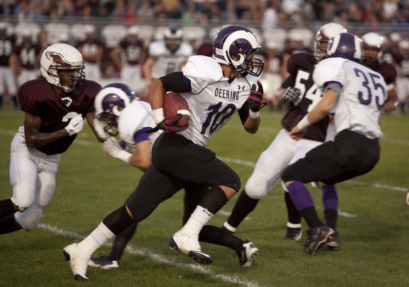 Renaldo Lowry, who continues to be a receiving and special-teams threat for Deering, races for a 45-yard punt return in the first quarter Friday night against Windham. The return set the Rams up for their first touchdown on the way to a 28-20 victory.