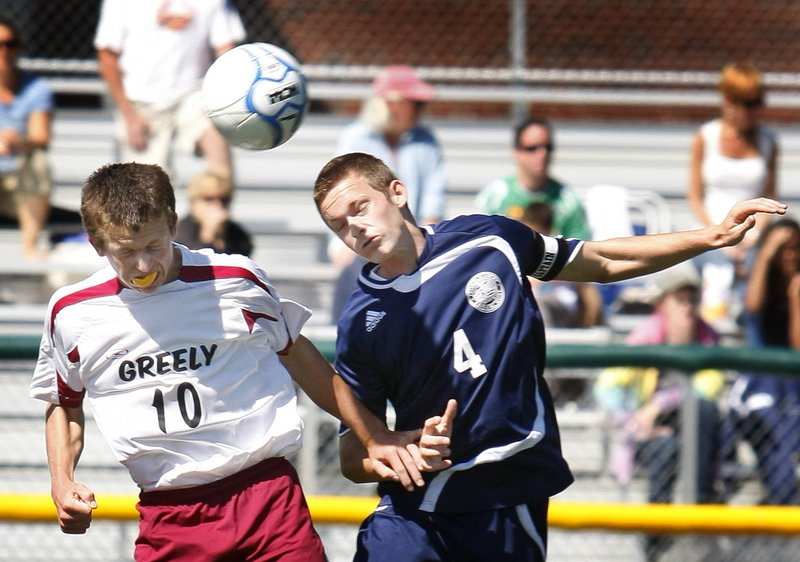 Matt Crowley, left, of Greely and Paul Kurnick of Fryeburg Academy compete for the ball Saturday during their Western Maine Conference schoolboy soccer game. Greely won 2-1 in the final second of the second overtime.