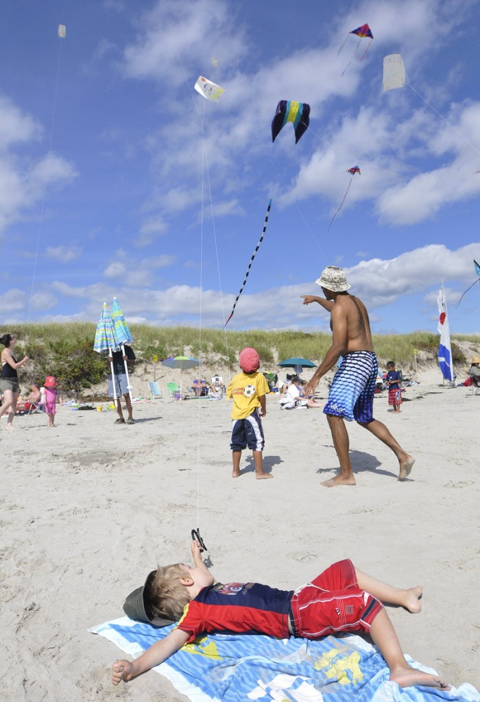 Hubert Pepin, 4, of Quebec takes it easy while flying his kite.