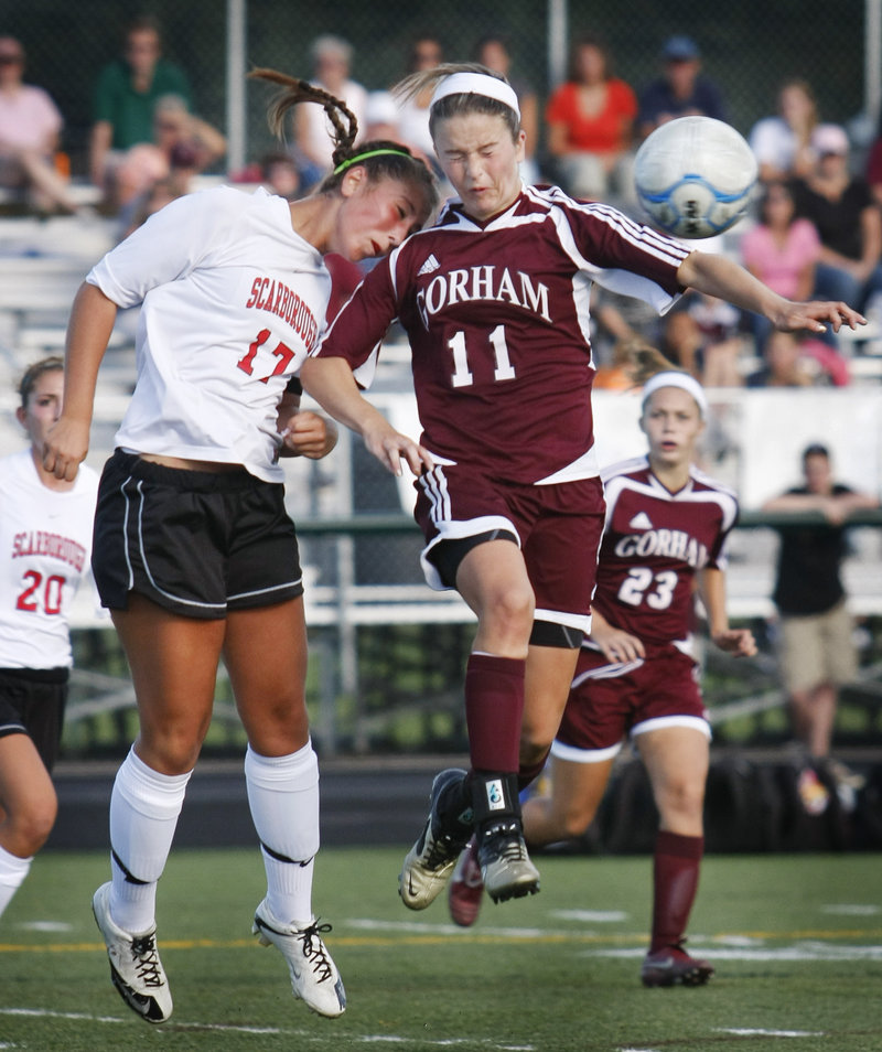 Jessica Broadhurst, left, of Scarborough and Kiersten Turner of Gorham react after a throw-in is headed away. Moving in are Ashley Ronzo, left, of Scarborough and Kate Hopkins of Gorham.