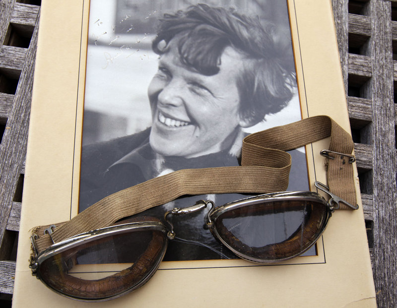 An original personal photo of Amelia Earhart dated 1937, along with goggles the aviator wore, are among items that raised more than $31,000 at auction.