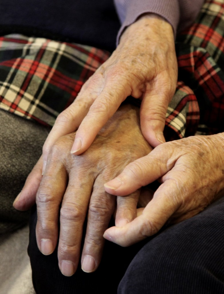 Shou-Mei Li holds the hand of her husband, Hsien-Wen Li, an Alzheimer's patient. By 2050, 13 million to 16 million Americans are projected to have Alzheimer's, costing $1 trillion in medical expenses.