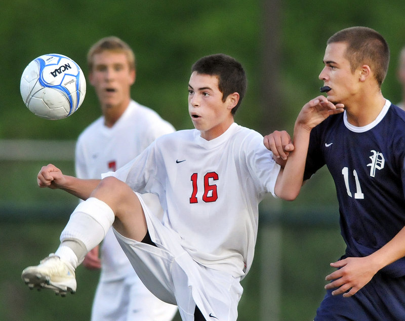 Sam Cekeda of Scarborough keeps his eye on the ball while holding off Portland's Paley Burlin during their 0-0 tie Tuesday at Scarborough.
