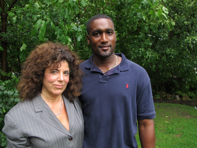 Albert Florence, shown with lawyer Susan Chana Lask, says he was strip-searched twice in 2005 when he was mistakenly arrested over a fine. The Supreme Court will decide whether such strip searches are constitutional.