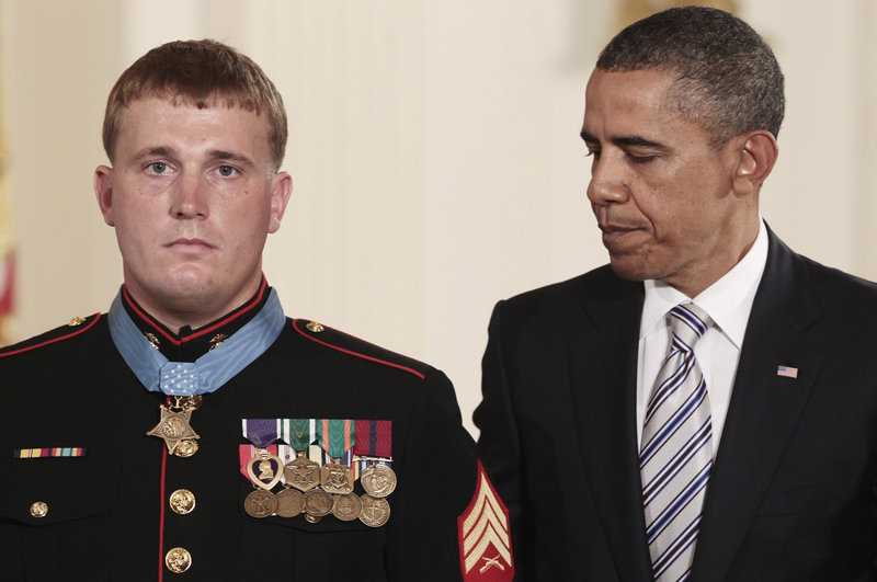 President Obama awards the Medal of Honor to former Marine Corps Cpl. Dakota Meyer, 23, of Greensburg, Ky., Thursday during a ceremony in the East Room of the White House.