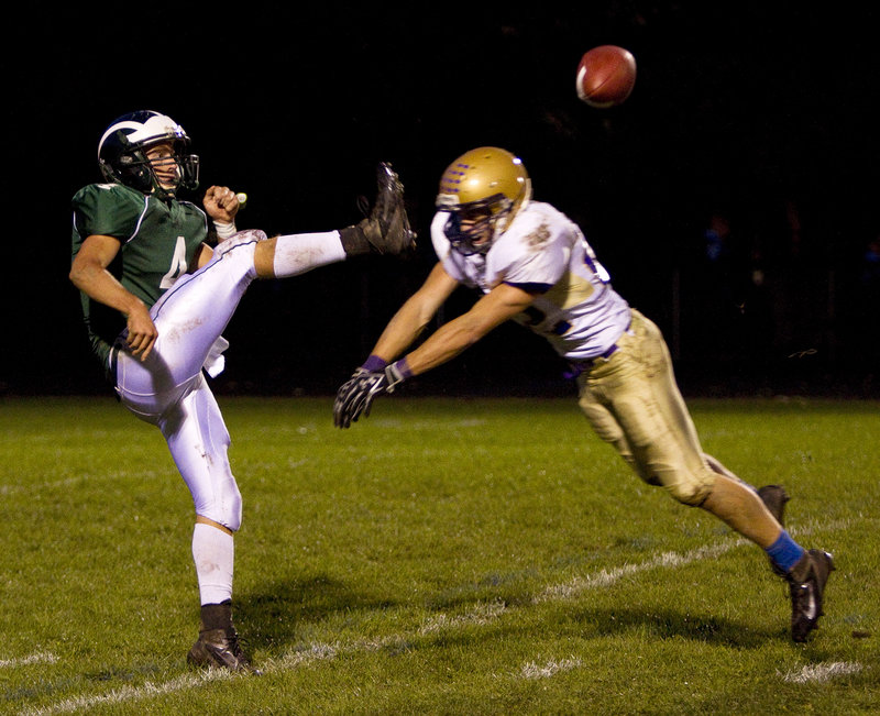 Donald Goodrich of Cheverus blocks a punt by Tyson Goodale of Bonny Eagle in the first quarter. Cheverus, the defending state champion, is 3-0.