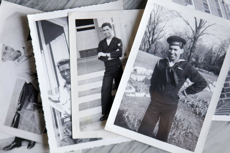 Photographs of Melvin Dwork, taken in 1943 when he was in the Navy, are on display at his home. The former corpsman now will be eligible for medical care and a military burial.