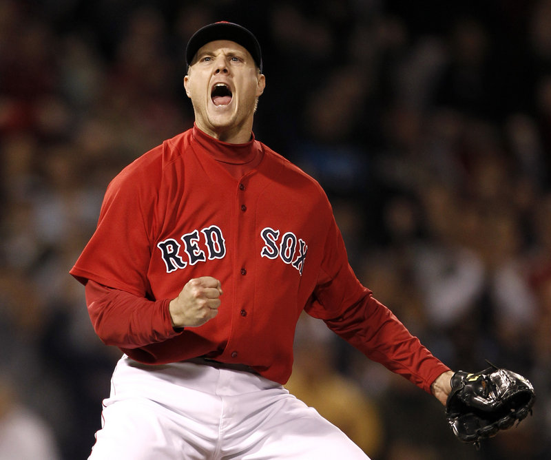 Jonathan Papelbon lets out a roar after striking out Tampa Bay's Evan Longoria to end Boston's 4-3 victory Friday night at Fenway Park.
