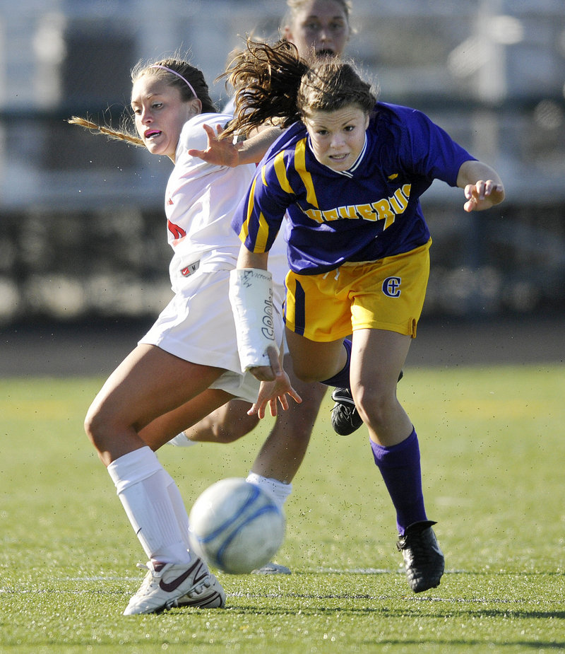Abby Maker of Cheverus attempts to keep her balance after colliding with Emily Howes of Scarborough.