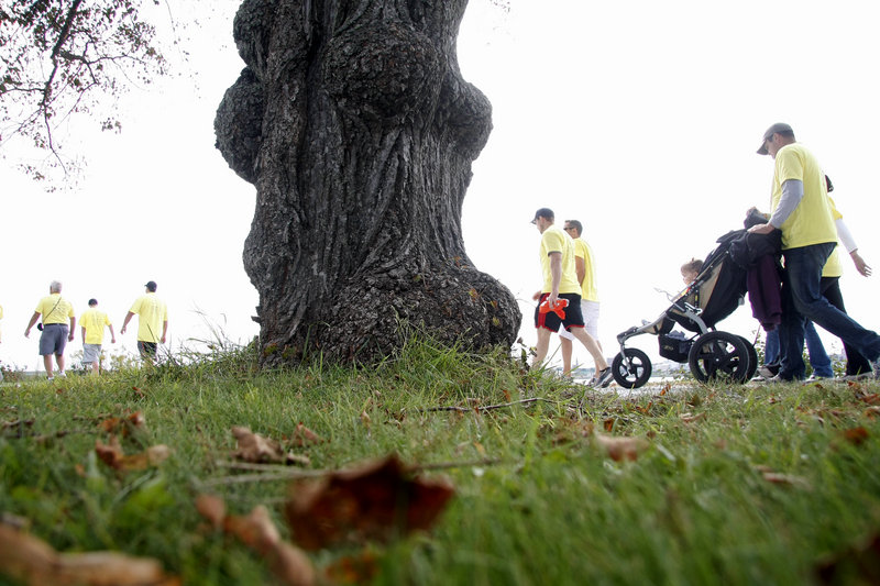 Team members head off around Back Cove during the 14th annual Juvenile Diabetes Research Foundation's Walk to Cure Diabetes at Payson Park in Portland on Sunday. The event raises funds for research into Type 1 diabetes, seen most often in children and young adults.