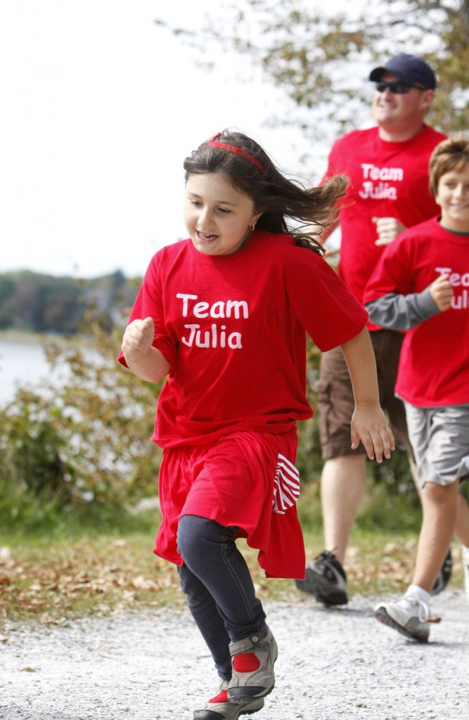 Team Julia's star, Julia Habib, 7, of Augusta, who has Type 1 diabetes, takes off around Back Cove with cousin John Owen Habib, 9, of Rhode Island and her uncle Jared Mills of Augusta not far behind during the Walk to Cure Diabetes.