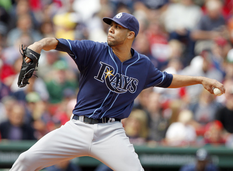 David Price was hit in the shoulder by a line drive but the Rays got an out on the play. Price was taken to a hospital for tests, which the team said were negative.