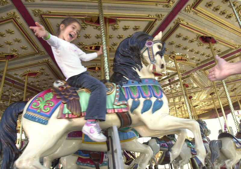 A youngster enjoys the carousel at the 2005 Cumberland County Fair.