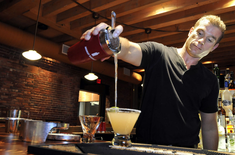 Matt Mullen, the bar manager at Gauchos Brazilian Steakhouse on Commercial Street, pours a Grand Martini, made with equal parts Jose Cuervo and Cointreau and a splash of Grand Marnier.