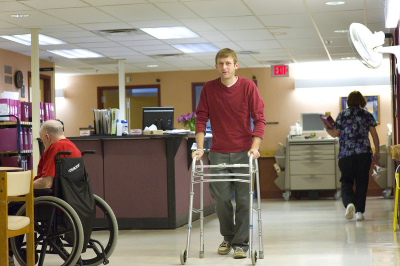 """Evan Carroll uses a walker to better understand the needs of residents at the Maine Veterans' Home in Scarborough. In March, he and his wife, Sasha Salzberg, started Bild Architecture to focus on housing for senior citizens. """"It's something we could get excited about because it's personal for us,"""" Carroll said."""