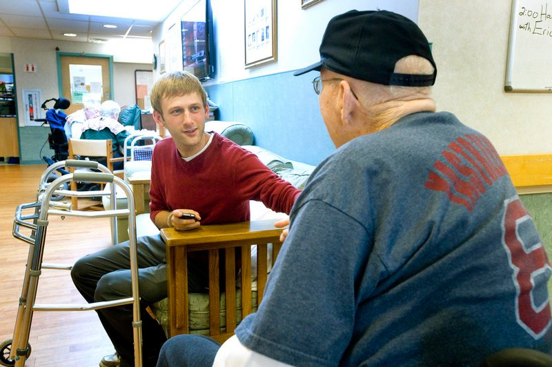 Architect Evan Carroll chats with a resident in the Alzheimer's unit.