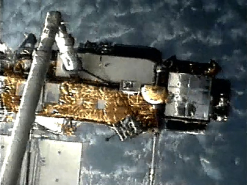 An image from NASA shows the Upper Atmosphere Research Satellite when it was deployed by space shuttle Discovery in 1991. Scientists say pieces of the 35-foot-long satellite will rain down at the end of the week.