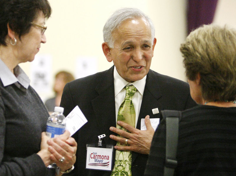 Ralph Carmona speaks with visitors during the