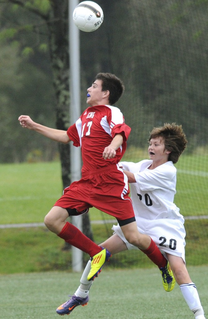 Tyler St. Pierre of Gray-New Gloucester tries to head the ball while chased by North Yarmouth Academy's Duncan George during a Western Maine Conference boys' soccer game Thursday at Yarmouth. The teams played to a scoreless tie.