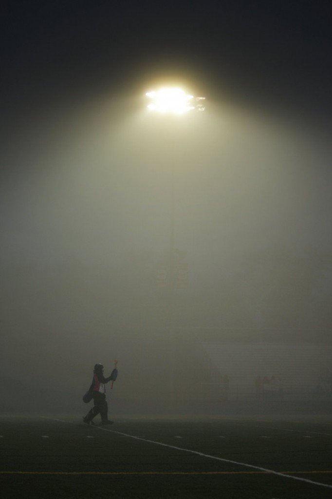 With the lights at the Mitchell Sports Complex in Scarborough showing just how foggy the night had become, Cheverus goalie Libby DesRuisseaux cheers on her teammates during a 2-1 loss to the Red Storm.