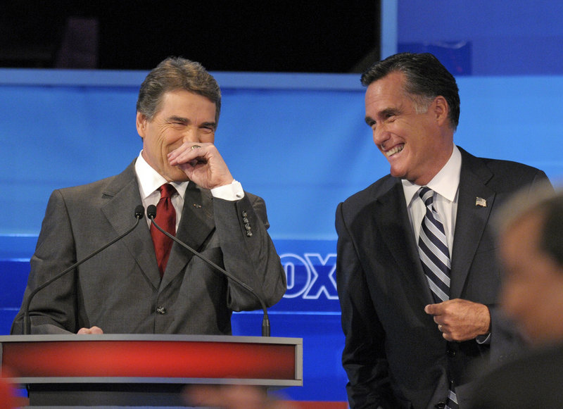 Candidates Texas Gov. Rick Perry, left, and former Massachusetts Gov. Mitt Romney share a light moment during a debate Thursday in Orlando, Fla. Romney and Perry were joined by seven other candidates: former Utah Gov. Jon Huntsman, Minnesota Rep. Michele Bachmann, Texas Rep. Ron Paul, former Pennsylvania Sen. Rick Santorum, former New Mexico Gov. Gary Johnson, former House Speaker Newt Gingrich and businessman Herman Cain.