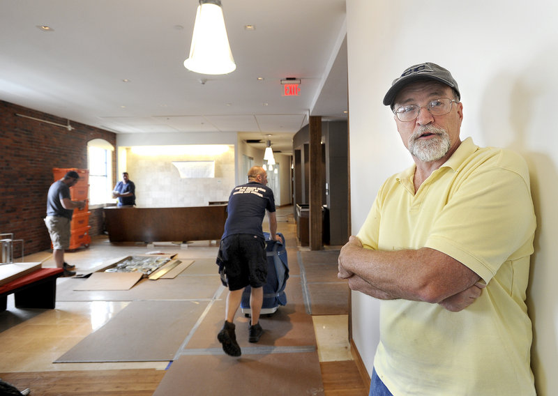 Facilities partner Dennis Keeler stands near the reception area Friday as the law firm Pierce Atwood moves into its fifth-floor offices.