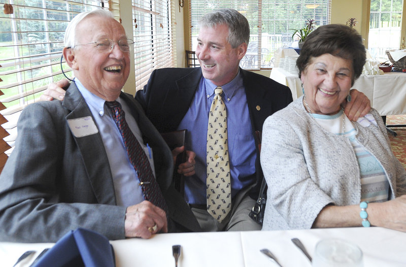 """Paul Varga of Falmouth and Dorothy Derhagopian of Cumberland Foreside flank Dr. Kenneth Myers at the 10th anniversary of his """"80/20 Club,"""" patients who have reached the milestone age of 80 and retained at least 20 of their own teeth."""