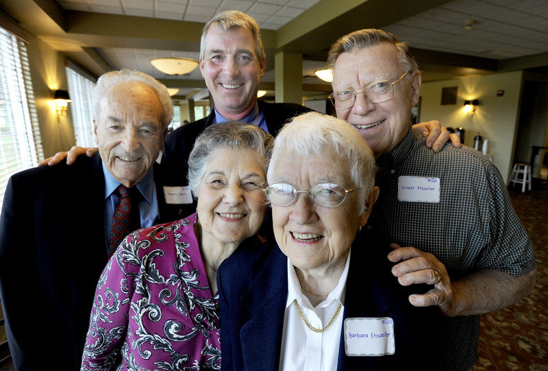 """Dr. Kenneth Myers, back center, honors Monty and Eleanor Small of Portland and Barbara and Ernest Etzweiler of Topsham, and 56 other members of his """"80/20 Club,"""" with a dinner at the Falmouth Country Club on Friday. """"I want to celebrate the fact that they've accomplished what I want as a dentist: all their teeth for their whole life,"""" he said."""