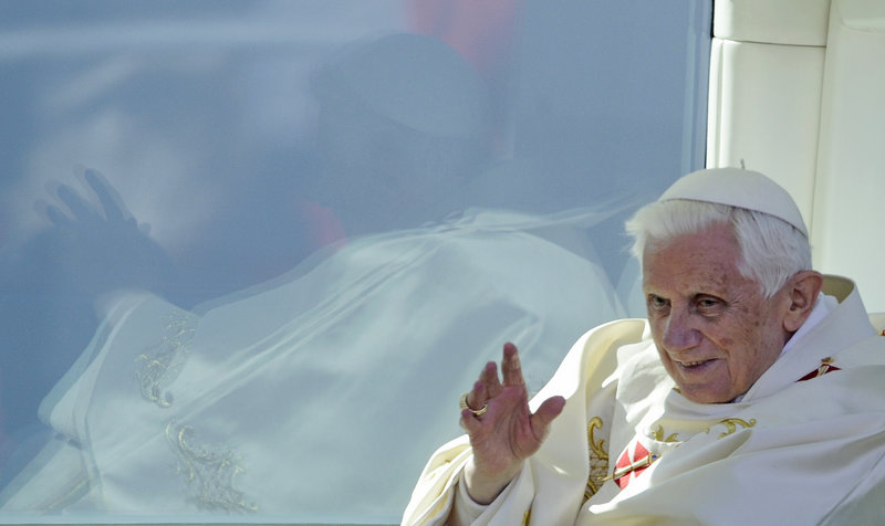 Pope Benedict XVI waves from his popemobile as he leaves the open-air Mass he celebrated in Erfurt, Germany, Saturday.