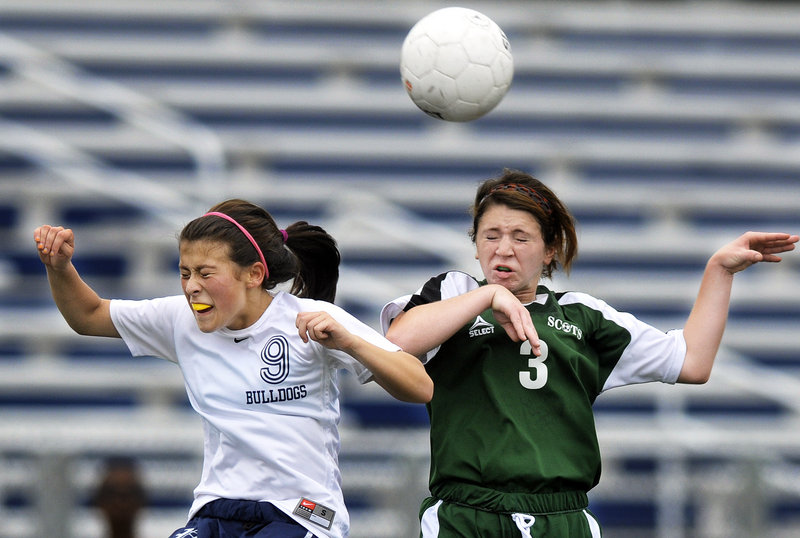 Rachel Glover, left, of Portland and Riley Kirk of Bonny Eagle compete for a header Saturday during Bonny Eagle's 2-1 victory in a schoolgirl soccer game at Fitzpatrick Stadium.