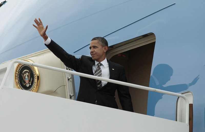 President Obama waves as he boards Air Force One before his departure from Andrews Air Force Base for the West Coast for several Democratic fundraisers Sunday.