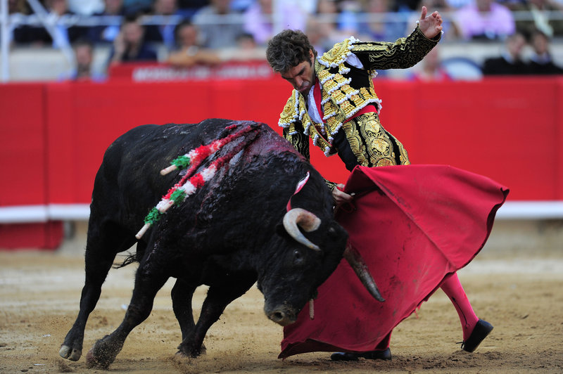 Bullfighter Jose Tomas performs at the Monumental bullring in Barcelona, Spain, on Sunday, as the region of Catalonia bid farewell to the country's emblematic tradition.