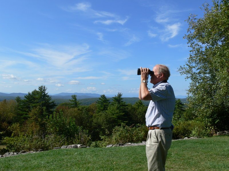 Dick Anderson, former Maine Audubon director, scans the skies around Hacker's Hill in Casco for migrating hawks. Some 170 hawks were observed recently during a watch organized by Loon Echo Land Trust, a group seeking to preserve the parcel.